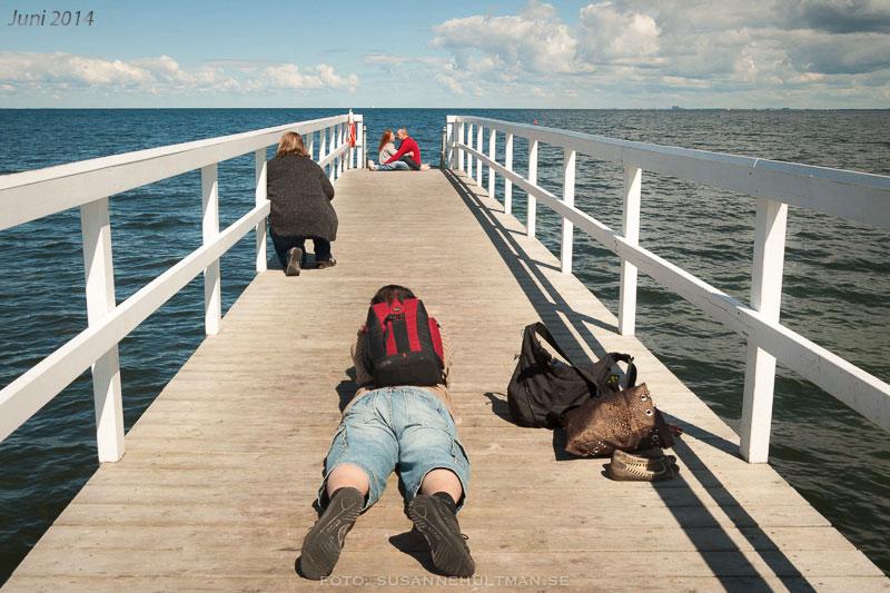 Fotografer på brygga.