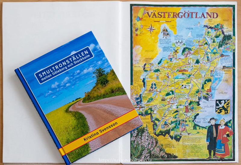 Kristinas bok och en kartbild av Västergötland.